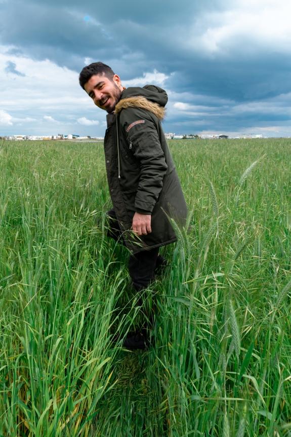 In March Paul making path walking sideways in a field