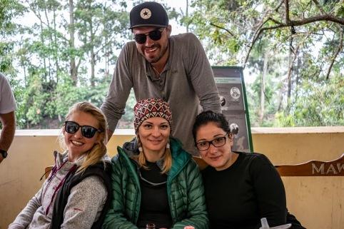 Three-women-one-man-smiling-after-hiking-Kilimanjaro